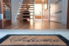Easy staging tips to help your house sell Replace old worn front door mat with a new one.