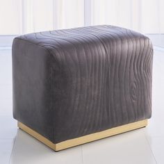 Global Views Enveloped in hand-dyed charcoal leather, the ottoman earns its name with distinctive faux bois-patterned quilting. A sleek plinth base in an antique satin gold finish grounds the piece beautifully. Upholstered Storage Bench, Tufted Ottoman, Ottoman Bench, Black Leather Ottoman, Leather Pouf, Clutter Free Home, Cocktail Ottoman, Extra Seating, Storage Spaces