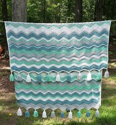 "Vintage inspired ""Ocean Waves"" ripple crochet blanket. Beautiful example of the neat ripple pattern. I love the tassels. There's a link to the random stripe generator in the post."
