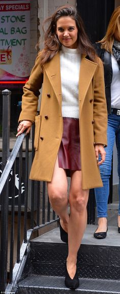 Fall ready: Katie Holmes, 37, was simple yet polished in an autumn appropriate peacoat, turtleneck and Acne Studios leather skirt as she hit the streets of New York City recently