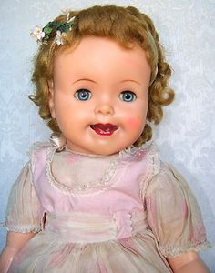 Ideal magic lips doll 1954, in original outfit. She cries and moves her lips when her stomach is squeezed.