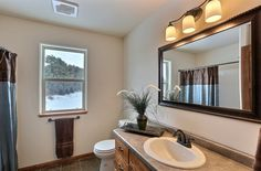 (FC26) Orchid II Floor Plan- Main Bathroom Countertop: Pionite Agatha Suede. Lakeview Forest Tile Flooring