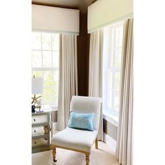 Inspiration for dressing two windows which are on different walls in the corner of a room. Design and photo by www.mainlinewindowdecor.com