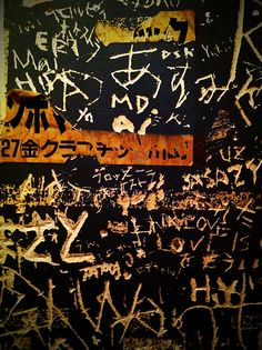 Scratched names (bathroom wall) (by ll_browneyes_ll )
