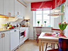neat small kitchen in red & white
