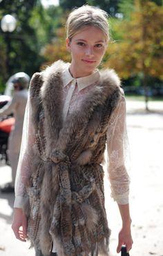 Fur vest over ivory lace blouse