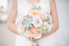 Love these pastel bridal flower bouquets - and those succulents!