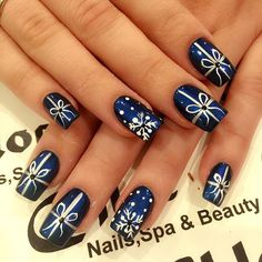 Pin for Later: 50 Festive Nail Art Ideas That Will Put You in a Celebratory Mood Winter Is a Wrap