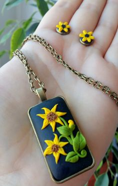 Sunflower made from polymer clay, bronze elements to wear