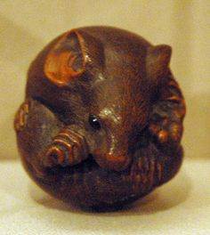 Mouse netsuke. Years ago the Metropolitan Museum produced very accurate plastic replicas (without any markings to indicate it came from the Met). I bought one just like this and later it was stolen with other genuine netsuke. I wonder how long the thief thought it was the real thing.