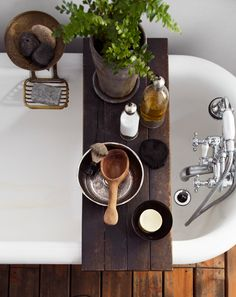 BATH / wood shelf in tub. w/ plants. <3