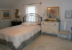 Bedroom ~ black nightstand originally ugly 60s wood; painted black and given crystal knobs; iron headboard from flea market