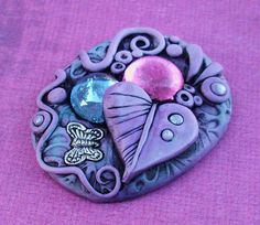A pretty little cabochon made of lilac polymer clay, metal charm and glass gems. Polymer Project, Polymer Clay Projects, Polymer Clay Creations, Polymer Clay Art, Polymer Clay Jewelry, Clay Crafts, Color Lila, Cute Clay, Clay Figures