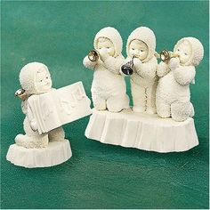 """- Set of 2 - Size: 5 x 2.75 x 5 & 2.5 x 2 x 4'' - 1998 Winter Celebration - Retired December, 1998 - Event Piece Limited To Year 1998 Production Department 56 Snowbabies """"Three Tiny Trumpeters"""" Item n"""