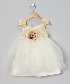 Perfect for twirling and swirling, this poufy frock is teaming with tulle and angelic accents. Ruched straps, feathers and a rich rose embellishment combine to craft a dreamy dress that begs to attend princess parties or other fanciful festivities!100% polyester exclusive of decorationDry cleanMade in the USA<...
