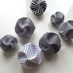 Paper baubles, made by three folded paper strips that almost magically plop in place to form a ball. Learn how to - and get the PDF at my blog.
