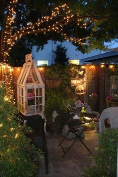 Inspiration for creating a retreat in a small yard- it's a bit busy for my taste but I love how cozy it is. #GardenLighting