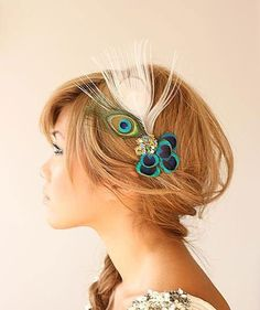 Peacock hair ornament. I could do this - I have some peacock feathers.