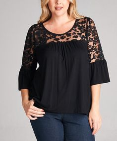 A sheer lace inset infuses the yoke of this curve-skimming top with a captivating pop of romantic appeal.