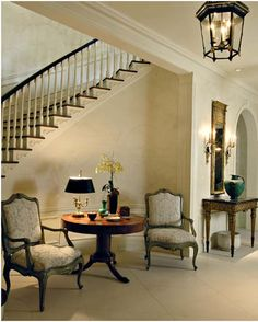 Stair landing decor on pinterest picture wall staircase for Furniture for curved wall in foyer