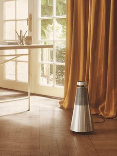 BeoSound 2: 360 Degree Wireless Speaker System. Here elegantly complementing a home studio interior.