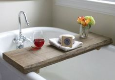 A wooden tray or board that you can slide over the tub is just soooo relaxing! You can fill a glass with your favorite drink, put a few candles, or even bring a book in!