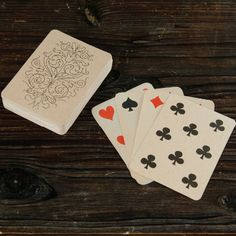 Scatter Vintage Playing Cards Across a Table