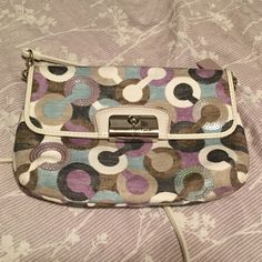 Sale! Like new clutch cross body handbag Signature coach c pattern, has no flaws at all. The strap is removable and the inside has spaces for credit cards. Great little bag  Send me an offer with the button  Coach Bags Clutches & Wristlets