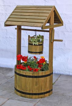 Wooden Decorative Wishing Well Planter - H1m x D45cm This decorative wishing well planter and garden ornament will create a lovely rustic atmosphere in your garden. Crafted from pine wood this wishing well will look amazing with all different kind of flowers. Features Ro