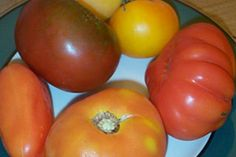 How to Grow Heirloom Tomatoes. Heirloom tomatoes add interest and great taste to summer dishes. It is quite economical to grow your own and even to do so organically. Heirloom tomatoes must be open-pollinated and must not be genetically. Prune Fruit, Tomato Seedlings, Tomato Plants, Canning Tomatoes, Summer Dishes, Tomato Garden, How To Can Tomatoes, Heirloom Tomatoes, Growing Tomatoes
