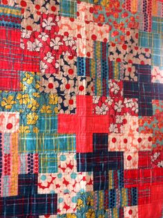 OMG .. look at the colours and pattern - a really original cross quilt