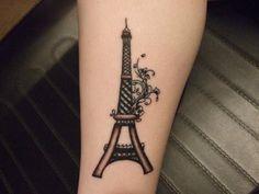 Eiffel Tower tattoo.