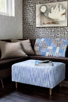 Instead of using expensive fabric, update a worn ottoman for little money by reupholstering it with a durable flat-weave rug. Learn how to do it >>