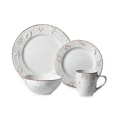 Thomson Pottery Hampton 16-Piece Stoneware Dinnerware Set: Create that seaside feel anywhere with this lovely dinnerware set. This off-white stoneware embossed with a seashell design will add the perfect coastal touch to your table.
