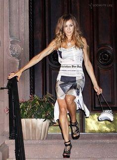 Carrie Bradshaw rocking the newspaper dress!