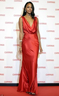 Lady in red:She stars in Campari's new short film, The Legend of Red Hand. And Zoe Saldana seemed to come dressed in character as she attended a photo call for the cocktail company's flick in Milan on Tuesday