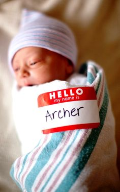 Newborn baby boy birth announcement with name tag