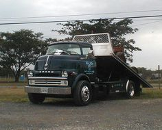 Dodge COE rollback. Sweet! this is perfect cummins turbo 6 , a crew cab might be a little better but wow