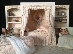 One piece ,reading nook with attached book shelfs. It is 1:12 scale.And measures 12 1/4 in length and 7 1/2 in height. It is fully dressed with
