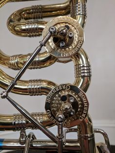 Machine work on the rotors of a Greenhoe Bass Trombone Brass Instrument, French Horn, Trombone, Classical Music, Musical Instruments, Horns, Inventions, Bass, Guitar
