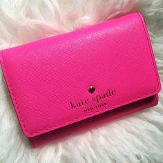 Kate Spade Darla Small Key Wallet Hot pink leather with light gold hardware and snap button closure.  Exterior ID slit and 1 open pocket on back.  Polka dot lined interior has 1 zip pocket and a key ring.  Brand new! kate spade Bags Wallets