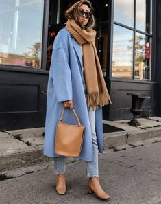 If you love neutral coloured fashion, this is the way to sport a soft blue coloured coat with a bunch of neutral accessories like a camel scarf, tan bag, and tan boots. (Le Fashion: How a Neutral-Lover Can Pull Off a Colorful Coat for Fall) Look Fashion, Girl Fashion, Fashion Outfits, Fashion Coat, Fashion Trends, Chic Fashion Style, Daily Fashion, Scarf Outfits, Ankara Fashion