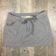 Gap gray sweatshirt material skirt Gap gray sweatshirt material skirt. Drawstring waist. Jean style with sweatpants material. Soft and confortbale! Sporty chic! Cotton acrylic. Tag reads XS. GAP Skirts Mini