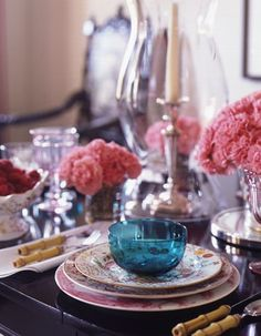 Joe Nye tablescape with pink carnations, hurricanes, bamboo flatware