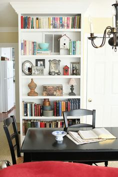 Love the way the crown molding wraps around the top of the bookcase. I must do this!