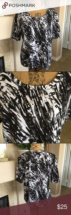 Chico's Animal Print Top Beautiful Black and White Animal Print top with a sprinkling of sequins on the front! Excellent condition! Chico's size 2 designed to fit size 12/14. Equivalent to a size large. Please see Chico's size chart in my closet.  Chico's Tops Tees - Short Sleeve