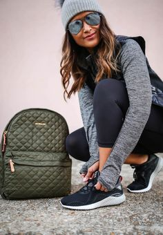haute off the rack, adidas alpha bounce running shoes, FinishLine, running shoes, rose gold headphones, metro backpack, MZ wallace, black crop leggings, black down vest, vest, 1/4 grey zip pullover, pullover, workout wear, grey pom beanie, active wear outfit, raybans