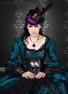Love the richly jewel toned hue of her beautiful teal gown. #dress #hat #costume #goth #gothic #woman #Halloween #skull #hair #teal #purple #black