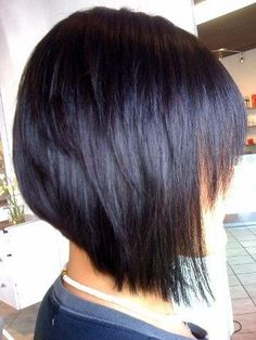 Razor line bob haircut with a hint of dark purple.