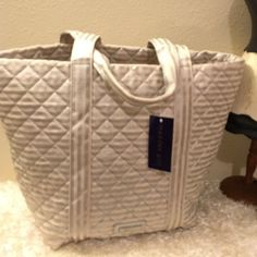 NWT Steve Madden XLg Canvas Silver Stripes Tote New with tags and absolutely no flaws canvas with silver metallic stripes extra large tote, two handle for over the shoulder comfort. Super great bag for overnight travel beach pool picnic and so much more. Clean and fun polka dot interior. Lightweight bag with tons and tons of room. Steve Madden Bags Totes